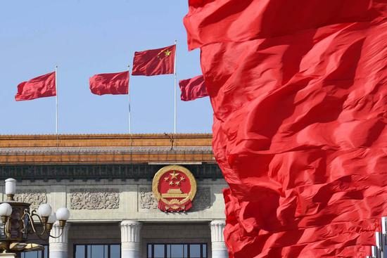 Flags are seen at the Tian'anmen Square and atop the Great Hall of the People during the opening meeting of the second session of the 13th National People's Congress in Beijing, capital of China, March 5, 2019. (Xinhua/Yang Zongyou)