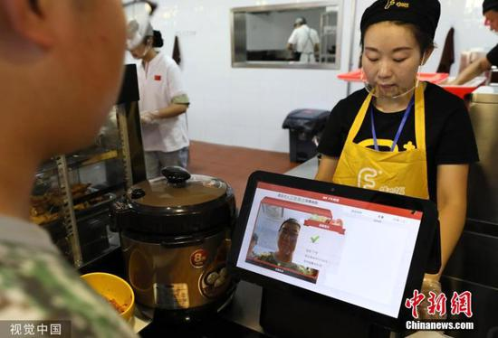 University students scan face to buy food