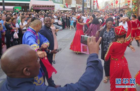 Envoys from 16 African countries and the African Union visited Xinjiang Uygur Autonomous Region from September 9 to 12. (Photo/Xinhua)
