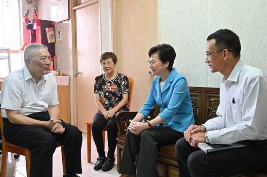 Chief Executive of the Hong Kong Special Administrative Region (HKSAR) Carrie Lam (R2) visits a couple of senior citizens at their home in Yau Ma Tei in Hong Kong on Sept. 13, 2019. (Credit: news.gov.hk)