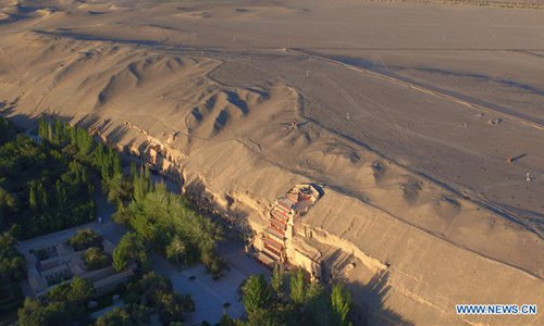 Aerial photo taken on Sept. 7, 2016 shows a view of the Mogao Grottoes in Dunhuang, northwest China's Gansu Province. (Photo/Xinhua)