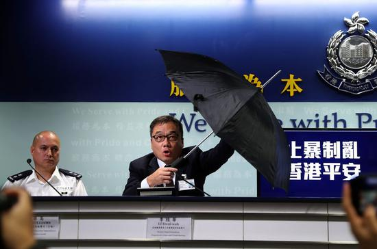 A police spokesman shows one of the weaponized umbrellas rioters used to attack officers, during a police press conference in Hong Kong, south China, Sept. 23, 2019. (Xinhua)