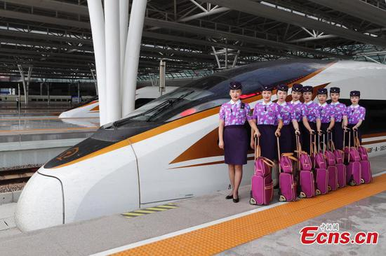 Train attendants in new uniforms for 70th PRC anniversary