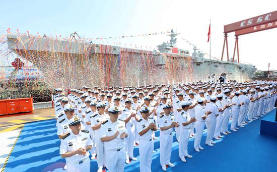 People's Liberation Army Navy officers attend the launch ceremony for China's first amphibious assault ship in Shanghai on Sept 25, 2019. [Photo by Li Tang/for chinadaily.com.cn]
