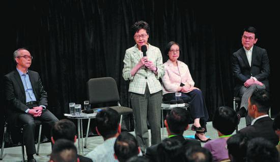 Hong Kong Chief Executive Carrie Lam Cheng Yuetngor speaks at the start of her first community dialogue at Queen Elizabeth Stadium in Wan Chai district on Thursday. (Photo/CHINA DAILY)