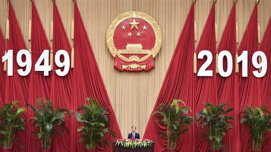 Wang Yang speaks at a reception celebrating the 70th anniversary of the founding the People's Republic of China (PRC) at the Great Hall of the People in Beijing, September 28, 2019. /Xinhua Photo