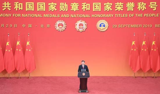 Chinese President Xi Jinping, also general secretary of the Communist Party of China Central Committee and chairman of the Central Military Commission, delivers a speech at the presentation ceremony of the national medals and honorary titles of the People's Republic of China at the Great Hall of the People in Beijing, capital of China, Sept. 29, 2019. (Xinhua/Yin Bogu)