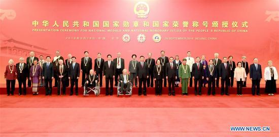 Chinese President Xi Jinping, also general secretary of the Communist Party of China Central Committee and chairman of the Central Military Commission, and other leaders join the awardees for a group photo after the presentation ceremony of the national medals and honorary titles of the People's Republic of China at the Great Hall of the People in Beijing, capital of China, Sept. 29, 2019. (Xinhua/Pang Xinglei)