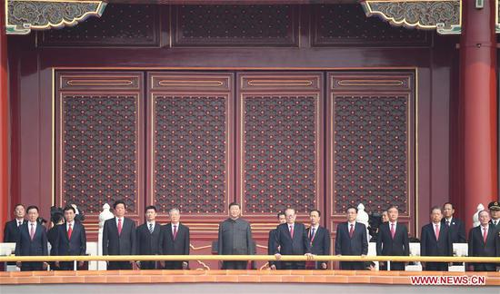 Chinese President Xi Jinping, also general secretary of the Communist Party of China (CPC) Central Committee and chairman of the Central Military Commission, is on the Tian'anmen Rostrum during the celebrations for the 70th anniversary of the founding of the People's Republic of China in Beijing, capital of China, Oct. 1, 2019. (Xinhua/Yan Yan)