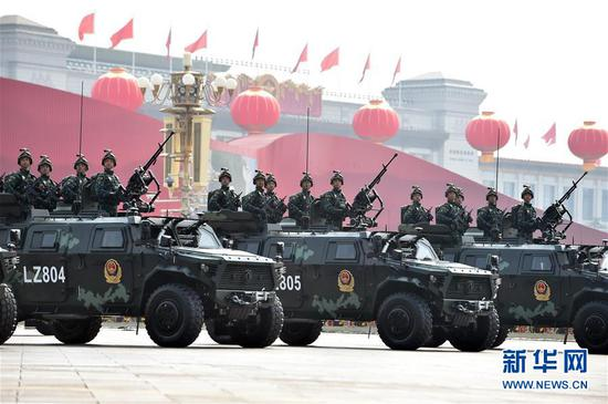 An anti-terrorist armed police force formation consisting of the country's newest anti-terrorist assault vehicles and armored anti-riot vehicles passed through the Tian'anmen Square on Oct. 1, 2019. (Photo/Xinhua)