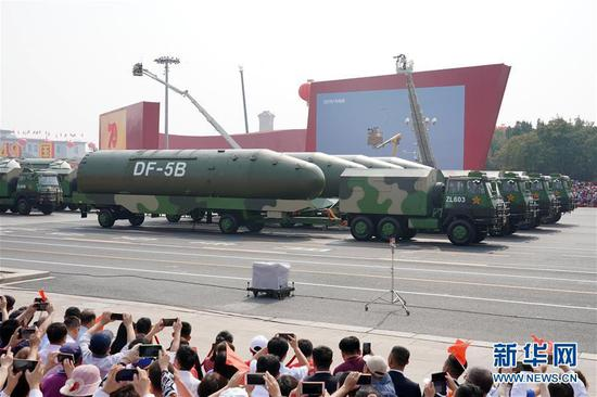 A formation of Dongfeng-5B nuclear missiles is reviewed during a military parade Tuesday in central Beijing, Oct. 1, 2019. (Photo/Xinhua)