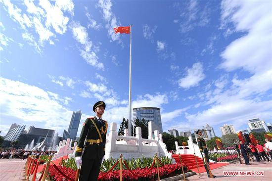 Photo taken on Oct. 1, 2019 shows a flag-raising ceremony to celebrate the 70th anniversary of the founding of the People's Republic of China in Fuzhou, capital of southeast China's Fujian Province. (Xinhua/Lin Shanchuan)