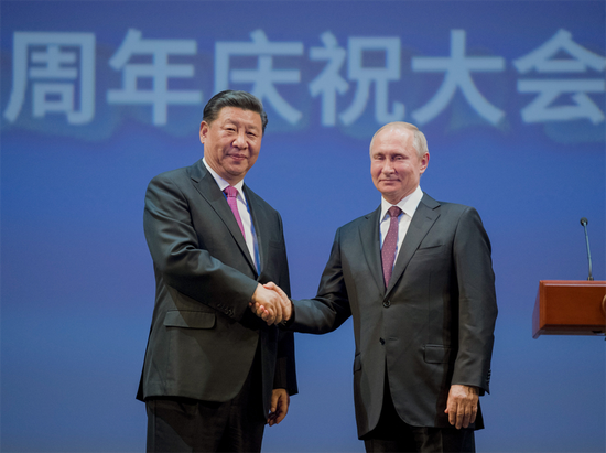 President Xi Jinping and his Russian counterpart Vladimir Putin attend a gathering marking the 70th anniversary of the establishment of diplomatic relations between the two countries in Moscow, Russia, June 5, 2019. (Photo/Xinhua)
