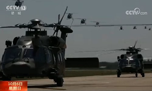 Z-20 utility helicopters prepare to take off from an undisclosed location. (Photo/China Central Television screenshot)