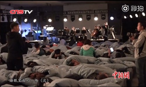 Audiences can sleep when they listen to the concert. (Photo/Screenshot of video posted by China News Service)