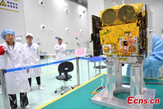 Technicians package the science experimental satellite BNU-1 at the Aerospace Dongfanghong Development in Shenzhen City, Guangdong Province, Aug. 14, 2019, before its transportation to the launch site. (Photo: China News Service/Chen Wen)