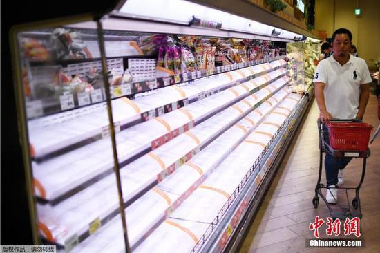 Alarmed residents rush to stock up on food as Typhoon Hagibis approaches