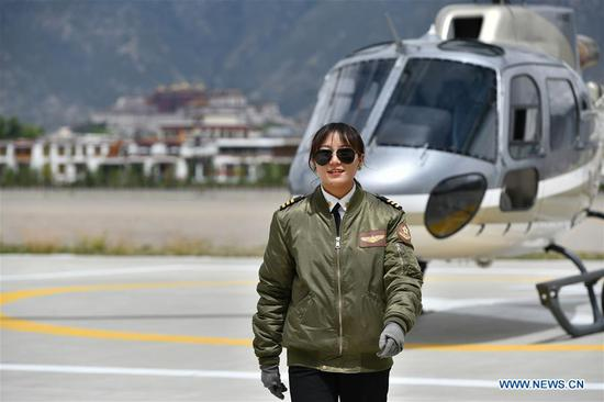 Female pilot from impoverished family flies helicopter in Tibet