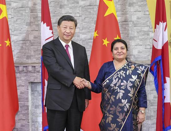 Chinese President Xi Jinping meets with Nepali President Bidya Devi Bhandari in Kathmandu, Nepal, Oct. 12, 2019. (Xinhua/Xie Huanchi)