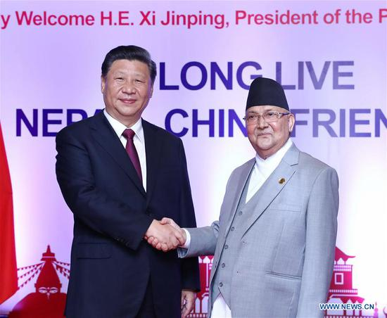 Chinese President Xi Jinping holds talks with Nepali Prime Minister K.P. Sharma Oli in Kathmandu, Nepal, Oct. 13, 2019. (Xinhua/Ju Peng)