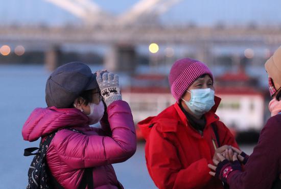 Cold air continuing its sweep southward