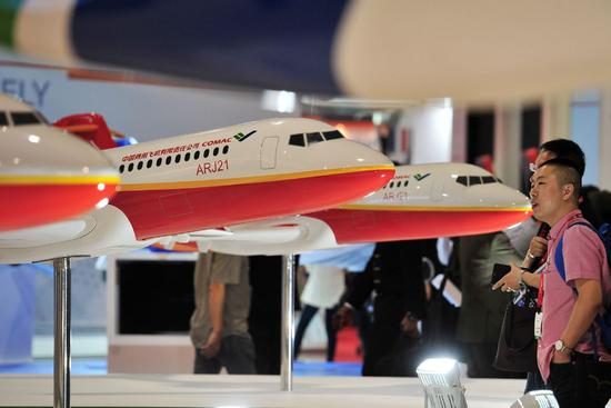 The booth of Commercial Aircraft Corp of China Ltd at an industry expo held in Singapore. (Photo/Xinhua)
