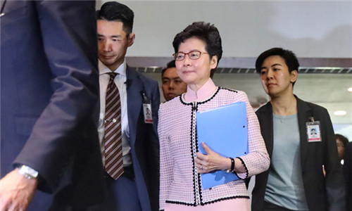 Hong Kong Chief Executive Carrie Lam Cheng Yuet-ngor arrives at the Legislative Council chambers in Hong Kong on Wednesday to deliver her annual policy address. (EDMOND TANG/CHINA DAILY)