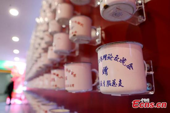 Drinking mugs, China's yesteryear signature, on show in Shanghai