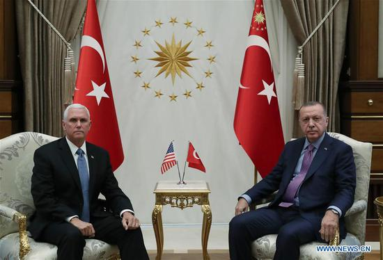 Turkish President Recep Tayyip Erdogan (R) meets with U.S. Vice President Mike Pence in Ankara, Turkey, on Oct. 17, 2019. The United States and Turkey on Thursday reached an agreement on a five-day truce and the establishment of a safe zone in northern Syria, where the Turkish forces had been fighting against the Kurdish militia, following talks between the two sides in the Turkish capital of Ankara. (Photo by Mustafa kaya/Xinhua)