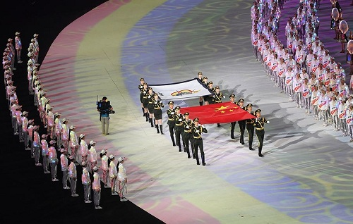 The national flag of the People's Republic of China and the flag of the International Military Sports Council (CISM) are carried into the stadium during the opening ceremony of the 7th CISM Military World Games in Wuhan, capital of central China's Hubei Province, Oct. 18, 2019. (Xinhua/Cheng Min)