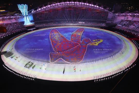 A huge dove is seen formed by people at the opening ceremony. (China Daily/Wang Zhuangfei and Xinhua/LI GA)