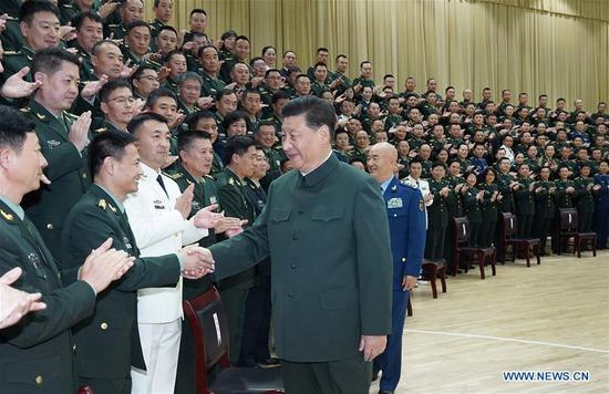 Chinese President Xi Jinping, also general secretary of the Communist Party of China (CPC) Central Committee and chairman of the Central Military Commission, meets with delegates to the first Party congress of the People's Liberation Army (PLA) Joint Logistic Support Force in Wuhan, capital of central China's Hubei Province, Oct. 18, 2019. (Xinhua/Li Gang)