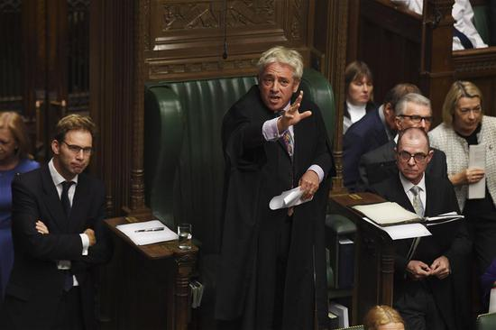 John Bercow (C), speaker of the British House of Commons, speaks at the House of Commons in London, Britain, on Oct. 21, 2019. The speaker of the British House of Commons, John Bercow, on Monday rejected a government's bid for a meaningful vote on the London-Brussels Brexit agreement in the day. (Jessica Taylor/UK Parliament/Handout via Xinhua)