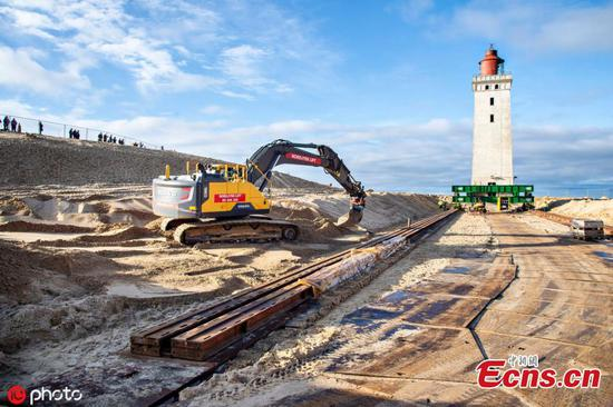 Danish lighthouse wheeled away from eroding coastline