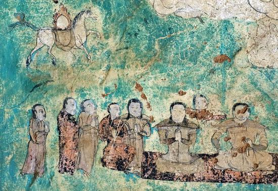 China to restore frescoes of grassland grottoes