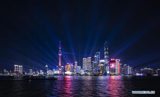 Photo taken on Sept. 26, 2019 shows a light show at Lujiazui area in Pudong District of east China's Shanghai. (Xinhua/Ren Long)
