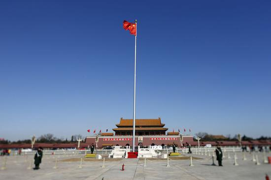 File photo shows a national flag flying at the Tian'anmen Square. (Xinhua/Shen Bohan)