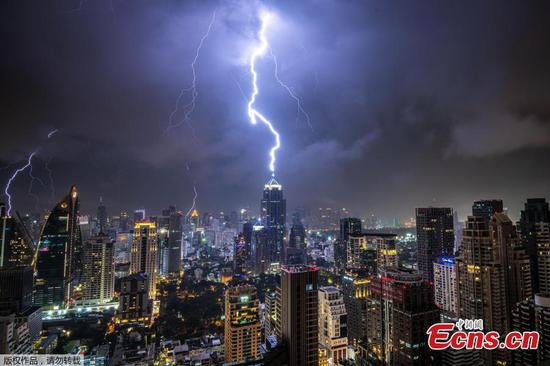 Lightning strikes Bangkok's Building during thunderstorm
