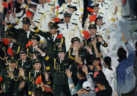 Members of the People's Liberation Army (PLA) chorus enter the stadium during the closing ceremony of the 7th CISM Military World Games in Wuhan, capital of central China's Hubei Province, Oct. 27, 2019. (Xinhua/Wan Xiang)