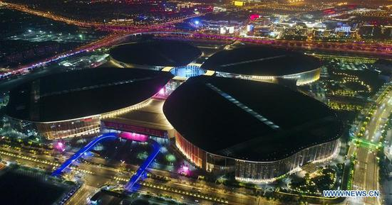 Aerial photo taken on Oct. 27, 2019 shows a night view of the National Exhibition and Convention Center (Shanghai), the venue of the second China International Import Expo (CIIE), in east China's Shanghai. (Xinhua/Ding Ting)