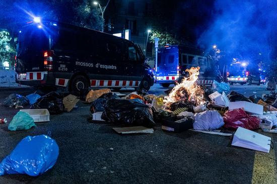 Trash is set on fire by Catalan pro-independence demonstrators near the headquarters of the Spanish National Police force in Barcelona, Spain, on Oct. 26, 2019. (Photo by Joan Gosa/Xinhua)
