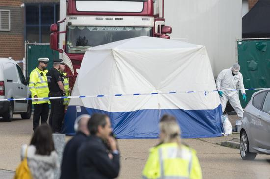 Police officers work at the scene where 39 bodies were found in a shipping container at Waterglade Industrial Park in Essex, Britain, on Oct. 23, 2019. (Photo by Ray Tang/Xinhua)
