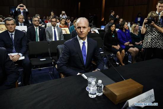 Boeing CEO Dennis Muilenburg (C) arrives to testify before U.S. Senate Committee on Commerce, Science and Transportation on Capitol Hill in Washington D.C., the United States, on Oct. 29, 2019.  (Photo by Ting Shen/Xinhua)