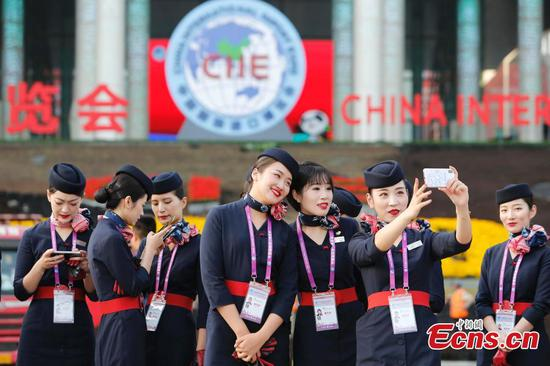 Flight attendants ready to serve import expo