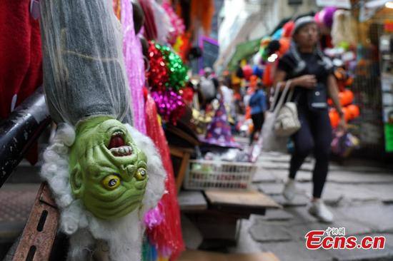 Halloween masks attract shoppers in Hong Kong