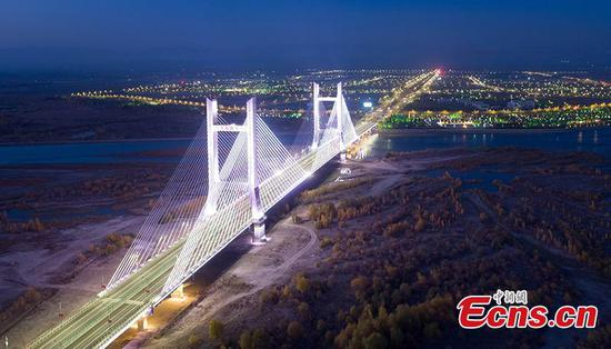 New bridge in Xinjiang sets historical record