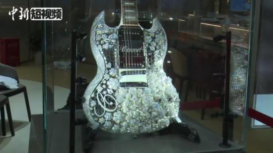 Glitzy guitar at CIIE