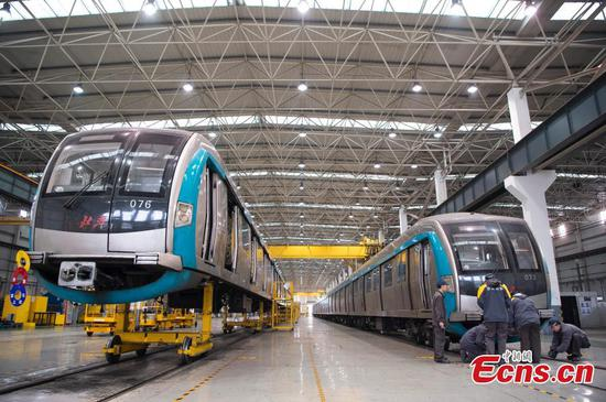 Beijing Metro trains under maintenance in workshop
