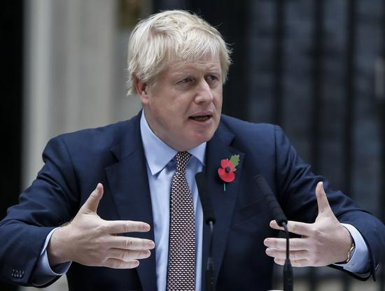 British Prime Minister Boris Johnson makes a statement outside 10 Downing Street in London, Britain on Nov. 6, 2019.(Xinhua/Han Yan)