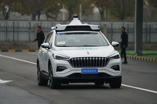 Self-driving cars with passengers make test runs in north China